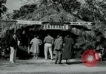 Image of tourists at Seminole Native American Indian trading post Miami Florida USA, 1936, second 3 stock footage video 65675031908