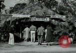 Image of tourists at Seminole Native American Indian trading post Miami Florida USA, 1936, second 5 stock footage video 65675031908