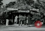 Image of tourists at Seminole Native American Indian trading post Miami Florida USA, 1936, second 8 stock footage video 65675031908