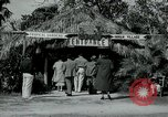 Image of tourists at Seminole Native American Indian trading post Miami Florida USA, 1936, second 9 stock footage video 65675031908