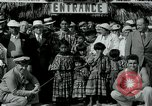 Image of tourists at Seminole Native American Indian trading post Miami Florida USA, 1936, second 22 stock footage video 65675031908