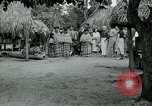 Image of tourists at Seminole Native American Indian trading post Miami Florida USA, 1936, second 29 stock footage video 65675031908