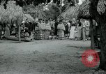 Image of tourists at Seminole Native American Indian trading post Miami Florida USA, 1936, second 31 stock footage video 65675031908