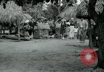 Image of tourists at Seminole Native American Indian trading post Miami Florida USA, 1936, second 33 stock footage video 65675031908