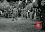 Image of tourists at Seminole Native American Indian trading post Miami Florida USA, 1936, second 37 stock footage video 65675031908