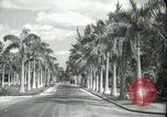 Image of car on a road Miami Florida USA, 1936, second 4 stock footage video 65675031913