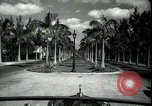 Image of car on a road Miami Florida USA, 1936, second 14 stock footage video 65675031913
