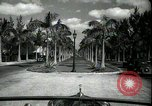Image of car on a road Miami Florida USA, 1936, second 16 stock footage video 65675031913