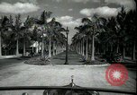 Image of car on a road Miami Florida USA, 1936, second 17 stock footage video 65675031913