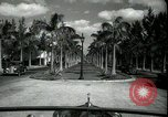 Image of car on a road Miami Florida USA, 1936, second 18 stock footage video 65675031913