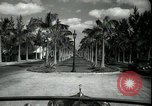 Image of car on a road Miami Florida USA, 1936, second 19 stock footage video 65675031913