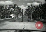 Image of car on a road Miami Florida USA, 1936, second 21 stock footage video 65675031913