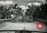 Image of car on a road Miami Florida USA, 1936, second 22 stock footage video 65675031913