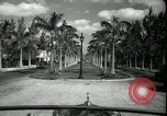 Image of car on a road Miami Florida USA, 1936, second 23 stock footage video 65675031913