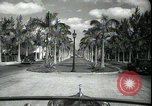 Image of car on a road Miami Florida USA, 1936, second 24 stock footage video 65675031913