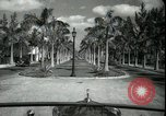 Image of car on a road Miami Florida USA, 1936, second 26 stock footage video 65675031913