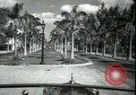 Image of car on a road Miami Florida USA, 1936, second 27 stock footage video 65675031913