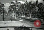 Image of car on a road Miami Florida USA, 1936, second 28 stock footage video 65675031913