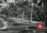 Image of car on a road Miami Florida USA, 1936, second 31 stock footage video 65675031913