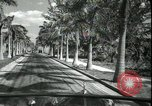 Image of car on a road Miami Florida USA, 1936, second 34 stock footage video 65675031913