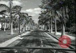 Image of car on a road Miami Florida USA, 1936, second 36 stock footage video 65675031913
