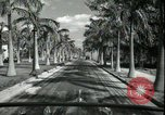 Image of car on a road Miami Florida USA, 1936, second 37 stock footage video 65675031913