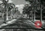 Image of car on a road Miami Florida USA, 1936, second 38 stock footage video 65675031913