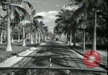 Image of car on a road Miami Florida USA, 1936, second 39 stock footage video 65675031913