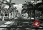 Image of car on a road Miami Florida USA, 1936, second 41 stock footage video 65675031913
