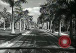 Image of car on a road Miami Florida USA, 1936, second 42 stock footage video 65675031913