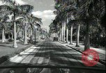 Image of car on a road Miami Florida USA, 1936, second 44 stock footage video 65675031913