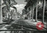Image of car on a road Miami Florida USA, 1936, second 47 stock footage video 65675031913