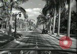 Image of car on a road Miami Florida USA, 1936, second 48 stock footage video 65675031913