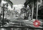 Image of car on a road Miami Florida USA, 1936, second 49 stock footage video 65675031913