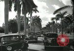 Image of car on a road Miami Florida USA, 1936, second 50 stock footage video 65675031913