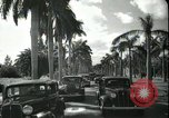Image of car on a road Miami Florida USA, 1936, second 51 stock footage video 65675031913