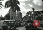 Image of car on a road Miami Florida USA, 1936, second 52 stock footage video 65675031913