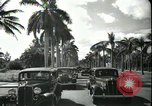 Image of car on a road Miami Florida USA, 1936, second 53 stock footage video 65675031913