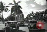Image of car on a road Miami Florida USA, 1936, second 54 stock footage video 65675031913