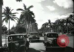 Image of car on a road Miami Florida USA, 1936, second 55 stock footage video 65675031913