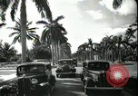Image of car on a road Miami Florida USA, 1936, second 56 stock footage video 65675031913