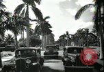 Image of car on a road Miami Florida USA, 1936, second 57 stock footage video 65675031913