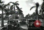 Image of car on a road Miami Florida USA, 1936, second 58 stock footage video 65675031913