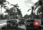 Image of car on a road Miami Florida USA, 1936, second 59 stock footage video 65675031913