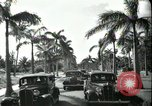 Image of car on a road Miami Florida USA, 1936, second 61 stock footage video 65675031913