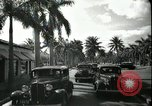 Image of car on a road Miami Florida USA, 1936, second 62 stock footage video 65675031913