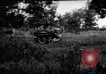 Image of camping in car United States USA, 1920, second 1 stock footage video 65675031931