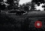 Image of camping in car United States USA, 1920, second 2 stock footage video 65675031931