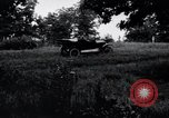 Image of camping in car United States USA, 1920, second 4 stock footage video 65675031931