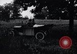 Image of camping in car United States USA, 1920, second 15 stock footage video 65675031931